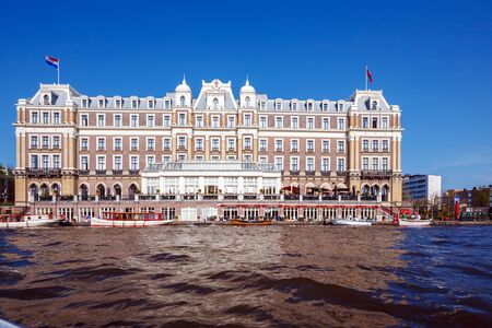 amstel: Building of Amstel Hotel from Canal, Amsterdam, Netherlands