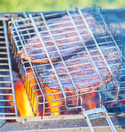 and fat: Two Ribeye Steaks Barbecue Cooking