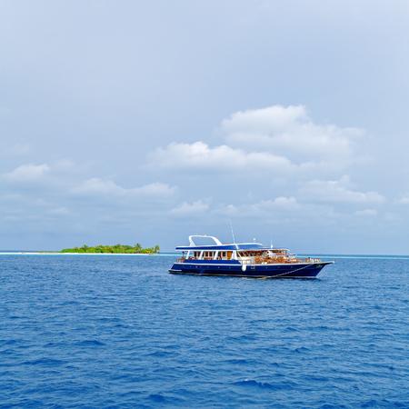 indian ocean: Safari boat and island, Maldives Stock Photo