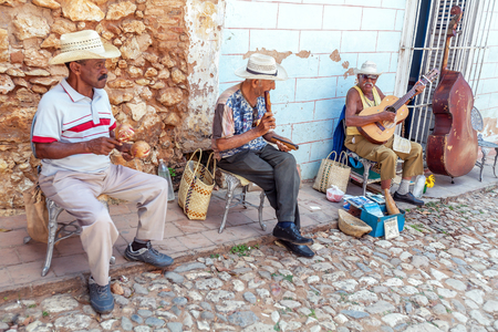 march band: TRINIDAD, CUBA - MARCH 30, 2012: street music band of four aged men Editorial
