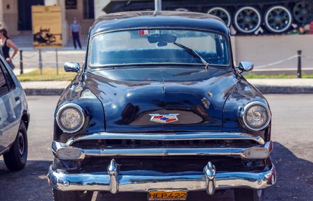 chevrolet: HAVANA, CUBA - APRIL 1, 2012: Black Chevrolet vintage car in front of Revolution museum