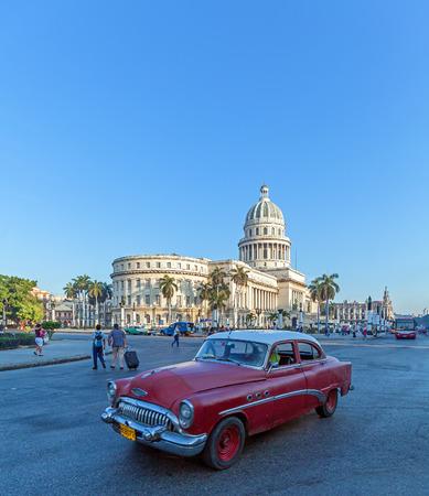 capitolio: HAVANA, CUBA - APRIL 2, 2012: Vintage black  car in front of Capitolio Editorial