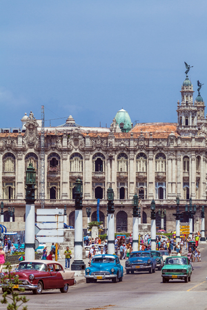 capitolio: HAVANA, CUBA - APRIL 1, 2012: Heavy traffic with taxi bikes and vintage cars in front of Capitolio Editorial