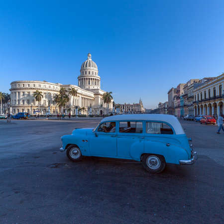 capitolio: HAVANA, CUBA - APRIL 2, 2012: Heavy traffic with vintage cars in front of Capitolio Editorial