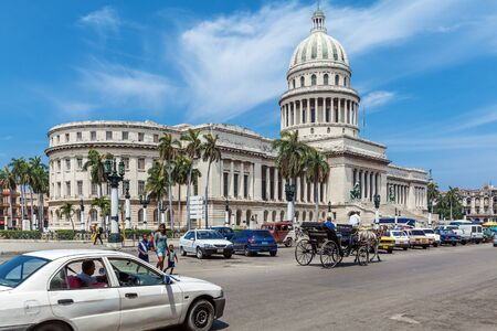 capitolio: HAVANA, CUBA - APRIL 1, 2012: Heavy traffic with horse carriages, motorbikes and vintage cars in front of Capitolio