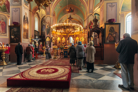 ecclesiastical: JERUSALEM, ISRAEL - FEBRUARY 15, 2013: Christians taking part in Eucharist. Saint Trinity Cathedral, main church of Russian orthodox mission.