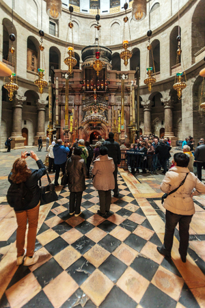 sepulcher: JERUSALEM, ISRAEL - FEBRUARY 16, 2013: Tourists waiting in long rows to enter Aedicule in Church of the Holy Sepulchre Editorial