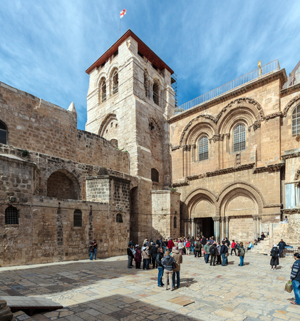 sepulcher: JERUSALEM, ISRAEL - FEBRUARY 15, 2013: Tourists entering main entrance of Holy Sepulchre Cathedral