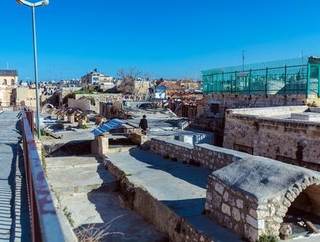 hasid: JERUSALEM, ISRAEL - FEBRUARY 20, 2013: Native people using roofs to walk across the city