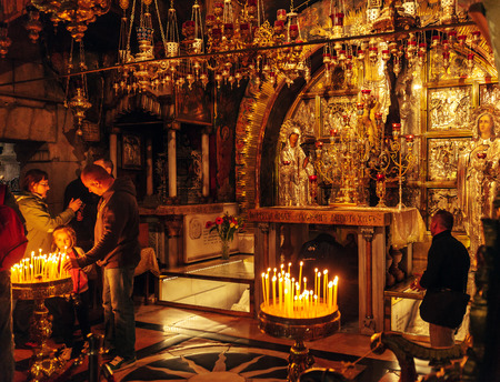 sepulchre: JERUSALEM, ISRAEL - FEBRUARY 17, 2013: Pilgrims praying near Golgotha Mountain in Temple of the Holy Sepulchre