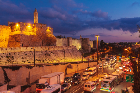 JERUSALEM, ISRAEL - FEBRUARY 19, 2013: Cars driving near Walls of Ancient City at Night