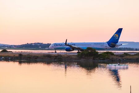 avia: CORFU AIRPORT, GREECE - JULY 11, 2011: Boeing 757 of Thomas Cook company at the airport Corfu