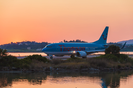 avia: CORFU AIRPORT, GREECE - JULY 11, 2011: Boeing 767 of Thomson company at the airport Corfu