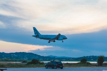 avia: CORFU AIRPORT, GREECE - JUNE 30, 2011: Airbus A319 of Aegean company at the airport Corfu