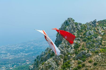 Enormous Turkey and North Cyprus flags between mountains near Saint Hilarion castle, Kyrenia mountain range, North Cyprus
