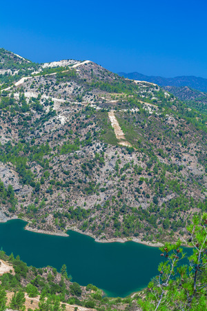 Kouris dam with reservoir, the largest of a network of 107 dams, 15 km from Limassol, Cyprus Stock Photo