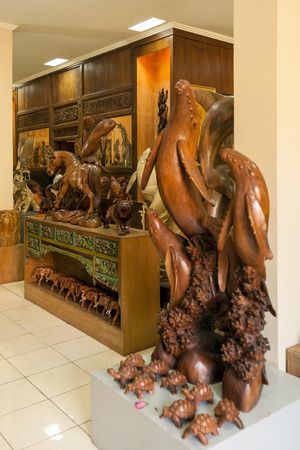 woodcraft: UBUD, INDONESIA - AUGUST 29, 2008: Carved wooden animal statues in souvenir shop