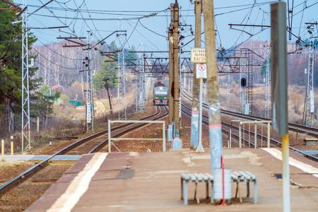 Russian suburban passenger train arriving to rural station