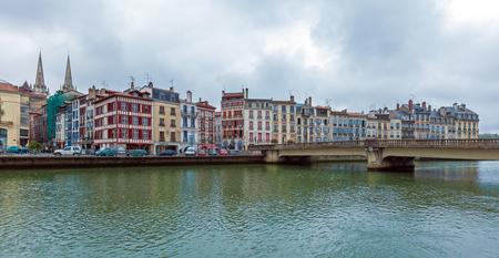 Old buildings along bank of Nive, Bayonne, France