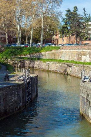 Old gates to Canal du Midi between Garonne River and sea, Toulouse, France