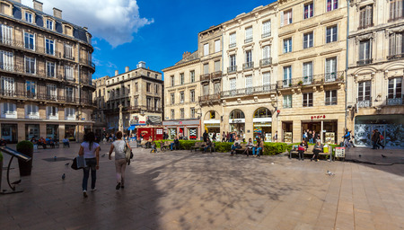 BORDEAUX, FRANCE - APRIL 4, 2011: French people walking at streets of old city with ancient homes