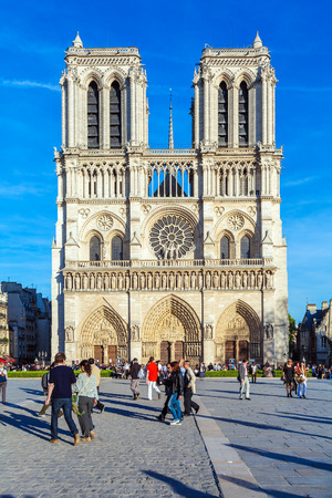 PARIS, FRANCE - APRIL 6, 2011: the French walk in front of Cathedral Notre Dame  (1160-1345) Editorial