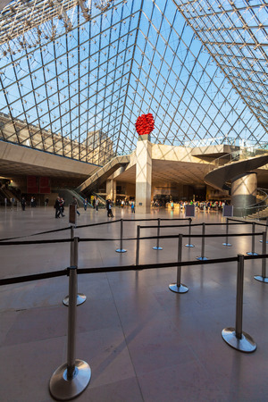 louvre pyramid: PARIS, FRANCE - APRIL 8, 2011: Visitors walking inside the Louvre Museum under Pyramid