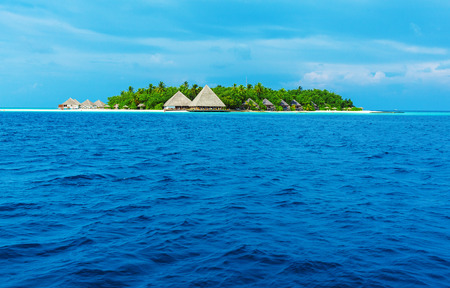 bungalows: Small atoll island with traditional wooden bungalows and Indian ocean, Maldives