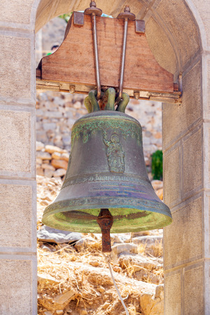 bell bronze bell: Monastery bronze small bell in Spinalonga fortress, Crete, Greece