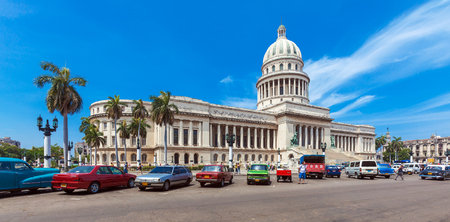 HAVANA, CUBA - APRIL 1, 2012: Many retro cars parked in front of Capitolio building Editorial