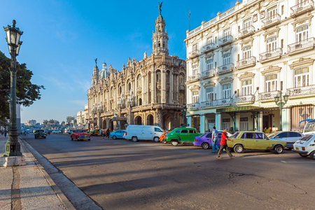 capitolio: HAVANA, CUBA - APRIL 2, 2012: Two vintage cars on the road in front of Great Theater Editorial