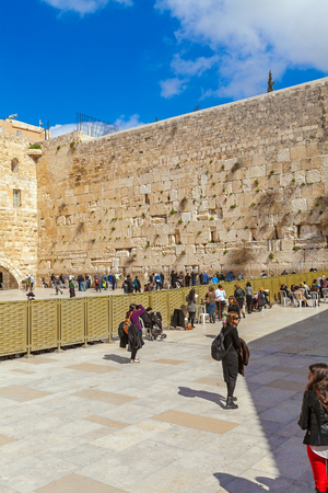 israel people: JERUSALEM, ISRAEL - FEBRUARY 17, 2013: People praying near Western Wall of Temple Editorial
