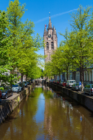 The building of the old Church  (Oude Kerk) on the banks of the spring canal in Delft, Netherlands