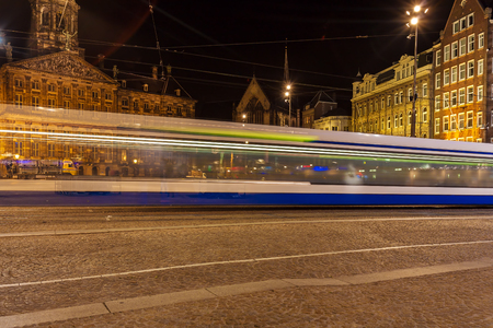 tramway: Dam square next to the Royal Palace in the centre of the city lit by night lights, Amsterdam, Netherlands