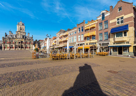 the old town hall: Council building (Stadhuis) and Central square surrounded by old houses in Delft, Netherlands