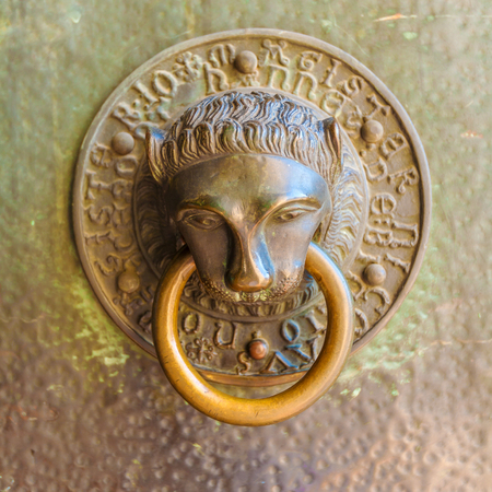 Vintage knocker in the form of a bronze lions head Stock Photo