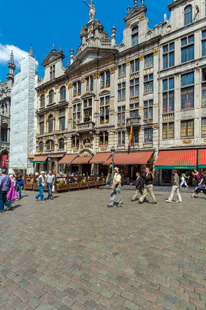 guildhalls: BRUSSELS, BELGIUM - APRIL 5, 2008:  Tourists walk in front of Guildhalls on the Grand Place square Editorial