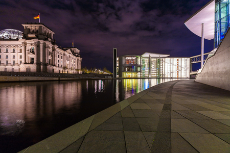 or spree: BERLIN, GERMANY - APRIL 2, 2008: New modern glass building of the Reichstag at night Editorial