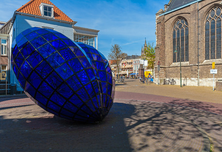 delft: DELFT, NETHERLANDS - APRIL 4, 2008:  Blue glass heart near New church, symbol of famous Delftware or Delft pottery, also known as Delft Blue