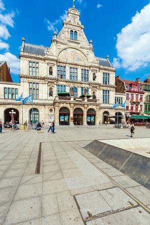 GHENT, BELGIUM - APRIL 6, 2008:  Tourists walk on Sint-Baafsplein with NTGent schouwburg, Performing Arts Theater Editorial