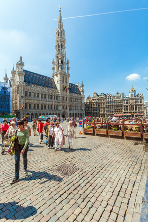 BRUSSELS, BELGIUM - APRIL 5, 2008:  Tourists walk in front of Guildhalls on the Grand Place square Editorial