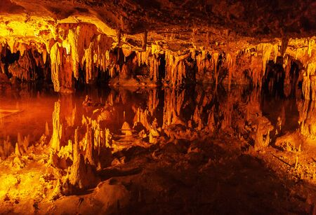 Stalactites and stalagmites with reflections in Mirror pond, Luray cave, Virginia, USA