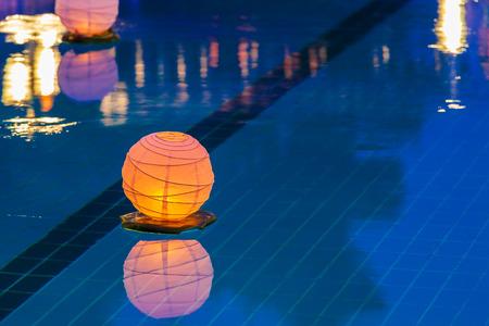 Floating orange water lantern in the pool