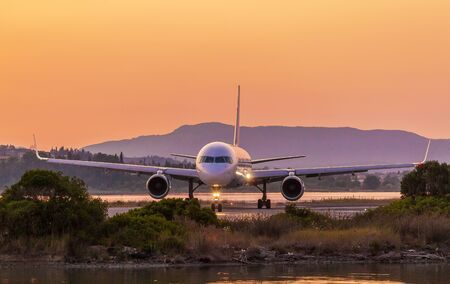 airstrip: Airplane on runway before take off in airport of Corfu Stock Photo