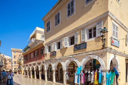 CORFU, GREECE - JULY 1, 2011: Tourists walk along the pedestrian shopping street of the old city