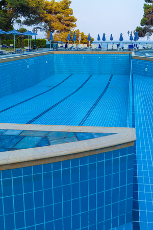 CORFU, GREECE - JULY 12, 2011: The large pool at the hotel after draining the water and cleaning procedures