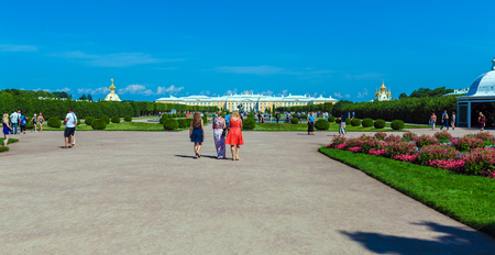 peter the great: SAINT PETERSBURG, RUSSIA - JULY 27, 2014:  Tourists walk in the Park with fountains in front of Royal Palace in Peterhof Editorial