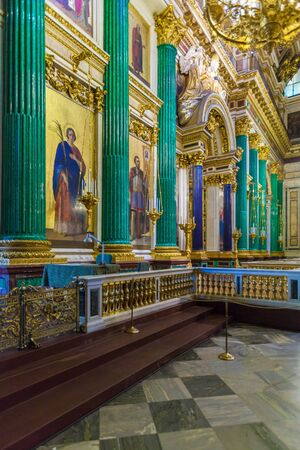 SAINT PETERSBURG, RUSSIA - JULY 26, 2014:  Tourists in the interior of St. Isaacs Cathedral looking at the model of the temple