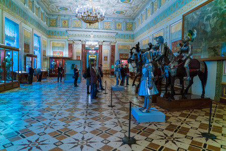 december 25: SAINT PETERSBURG, RUSSIA - DECEMBER 25, 2016: Tourists visiting Middle age military hall in Hermitage Museum with weapon and horses Editorial