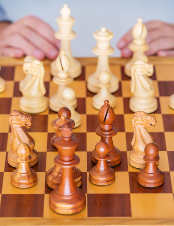 battle plan: Middle game - the player thinks over the position on a chess Board
